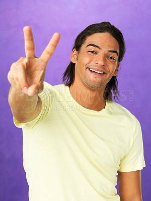 Buy stock photo Portrait of happy man giving peace sign