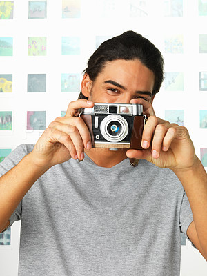 Buy stock photo Portrait of happy man making snapshot with retro camera