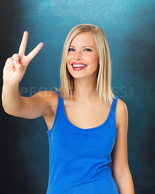 Buy stock photo Pretty young woman giving peace sign