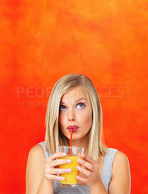 Buy stock photo Closeup of pretty woman sipping orange juice