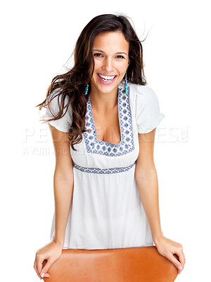 Buy stock photo Portrait of a pretty young fashion model standing by the chair against white background