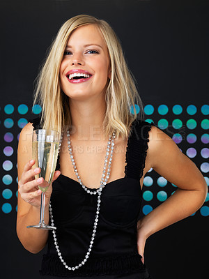 Buy stock photo Smiling woman holding glass of champagne