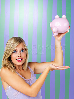 Buy stock photo Portrait of pretty woman holding piggybank upside down