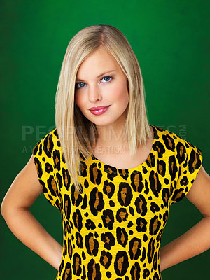 Buy stock photo Portrait of beautiful young woman posing on green background