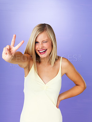 Buy stock photo Portrait of pretty young woman giving peace sign