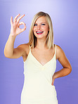 Woman making ok gesture
