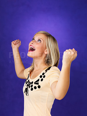 Buy stock photo Surprised young woman with her clenched fist