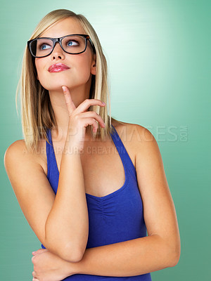 Buy stock photo Woman in glasses daydreaming on green background