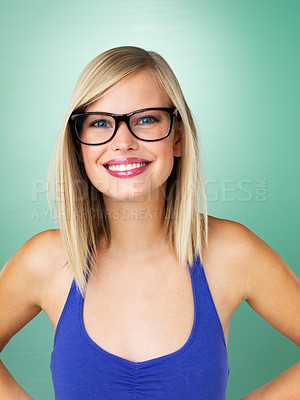 Buy stock photo Portrait of beautiful young woman in hipster glasses smiling against a fresh green background