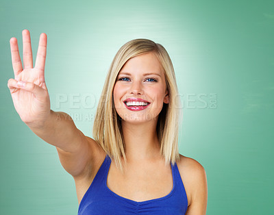Buy stock photo Pretty woman holding up three fingers