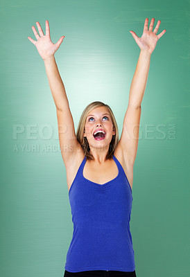 Buy stock photo Woman holding arms up in excitement