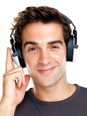 Buy stock photo Portrait of a happy young man listening to peaceful music on headphone against white background