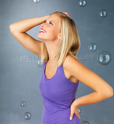 Buy stock photo Side view of pretty woman with hand in hair looking up