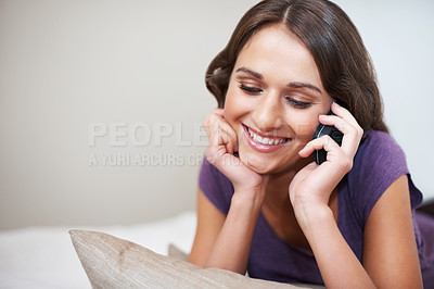 Buy stock photo Charming teen smiling while on the phone with face in hand