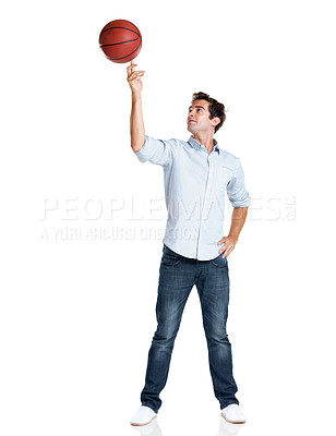 Buy stock photo Portarit of a happy young man playing with basketball over white background