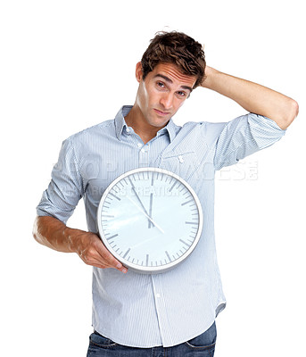 Buy stock photo Portrait of a confused young man holding a clock in hand on white background