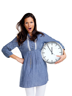 Buy stock photo Portrait of an angry young female screaming with a clock against white background