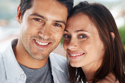 Buy stock photo Closeup portrait of a happy young couple looking at you with a warm smile