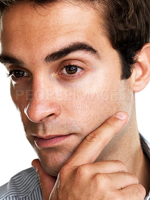 Buy stock photo Closeup portrait of a thoughtful young man looking away with hand on chin on white background