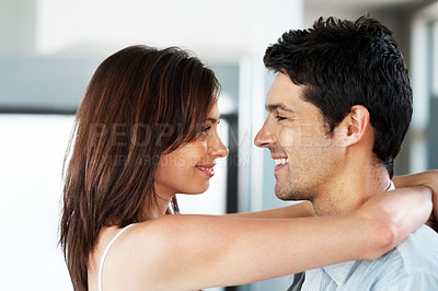 Buy stock photo Closeup portrait of a happy young couple looking face to face