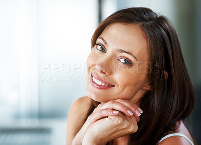Buy stock photo Closeup portrait of a lovely young woman looking with a sweet smile