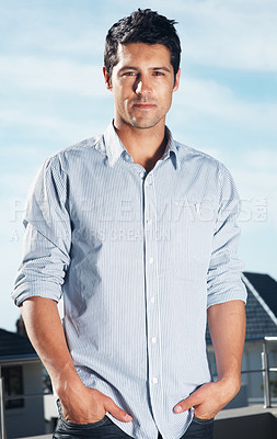 Buy stock photo Portrait of a handsome young man standing with his hands in pockets - Outdoor