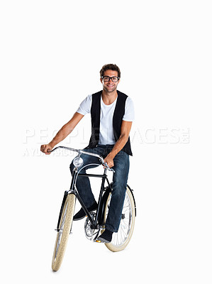 Buy stock photo A casually dressed man riding his vintage bike to work