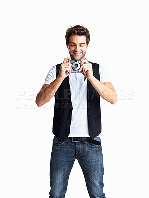 Buy stock photo Happy man looking at his camera settings