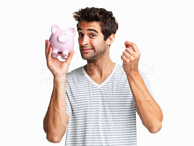 Buy stock photo Man holding up piggy bank with look of concern