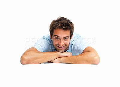 Buy stock photo Happy man lying on the floor resting his chin on his hand