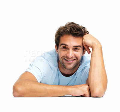 Buy stock photo Man lying on the floor resting face on hand