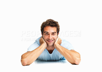 Buy stock photo Man lying on the floor with hands on neck