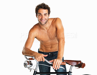 Buy stock photo Attractive shirtless man standing with his bicycle