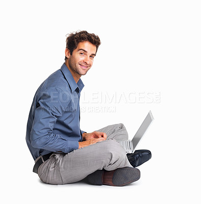 Buy stock photo Executive sitting on the floor cross-legged with laptop