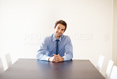 Buy stock photo Portrait of smiling business man sitting at the head of the table