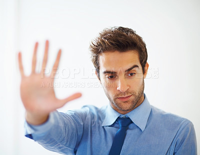 Buy stock photo Closeup of young executive showing stop gesture