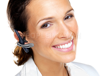 Buy stock photo Closeup portrait of a smiling young business woman using handsfree against white background