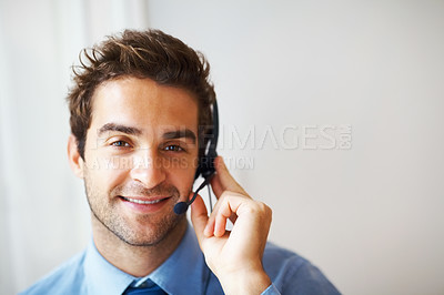 Buy stock photo Closeup portrait of happy young call center rpresentative smiling at you wearing a headset alongside copyspace