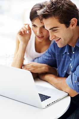 Buy stock photo Portrait of a smiling young couple working together on a laptop