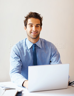 Buy stock photo Portrait of smiling business man using laptop