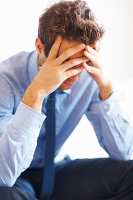 Buy stock photo View of businessman sitting with hands on face