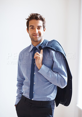 Buy stock photo Happy executive casually holding jacket over shoulder