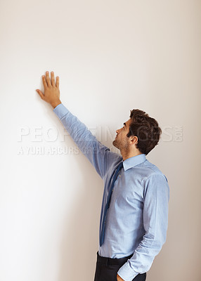 Buy stock photo Businessman standing and holding hand against wall indoors