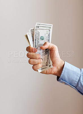 Buy stock photo Executive holding out handful of money