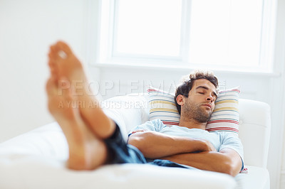 Buy stock photo Man lying down on sofa, focus on face