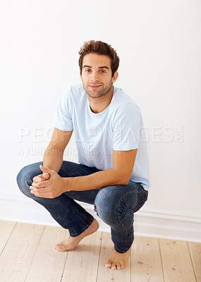 Buy stock photo View of man crouching down in bare feet