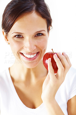 Buy stock photo Portrait of young brunette woman holding red apple isolated on white background