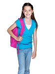 Happy little girl standing with schoolbag on white