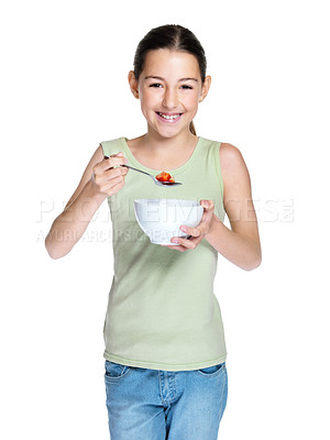 Buy stock photo Portrait of a cute young girl eating fruit against white background