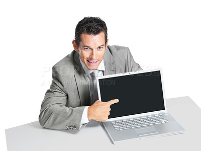 Buy stock photo Portrait of a successful young male entrepreneur pointing at laptop screen against white background